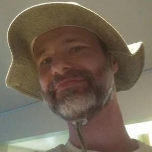 Joe Allen smiling with hat