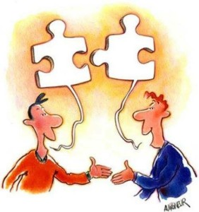 two-people-shake-hands-each-with-different-puzzle-piece-collaboration-and-cooperation-can-achieve-much-division-of-labor-specialization