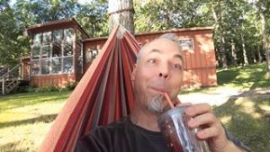 Doug in Hammock In Front Of House